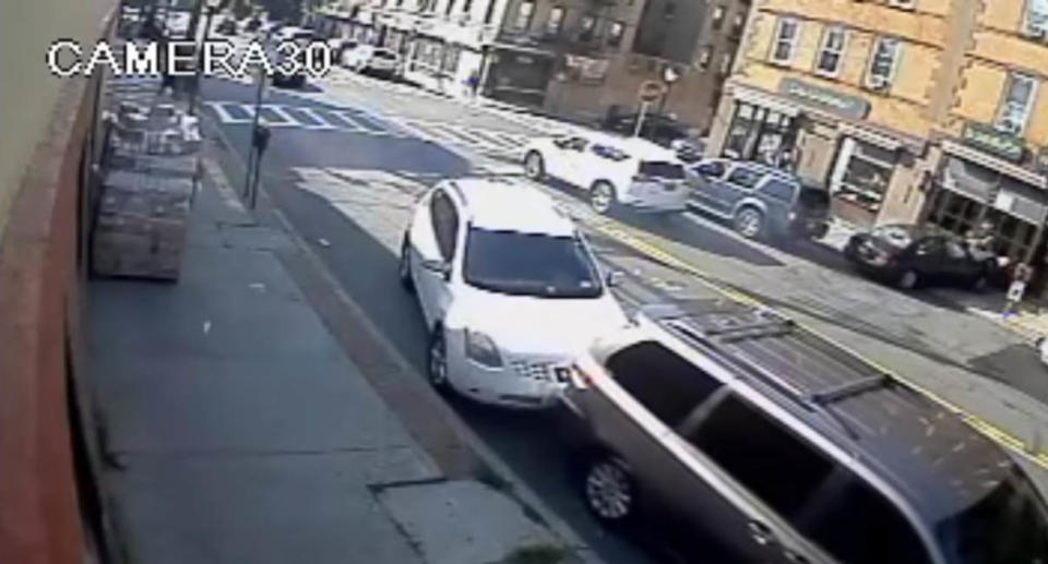 A screenshot of security footage showing the moment an out-of-control driver slammed into a parked car and struck an unsuspecting mum crossing the street with her 8-month-old. Source: Yonkers Police Department