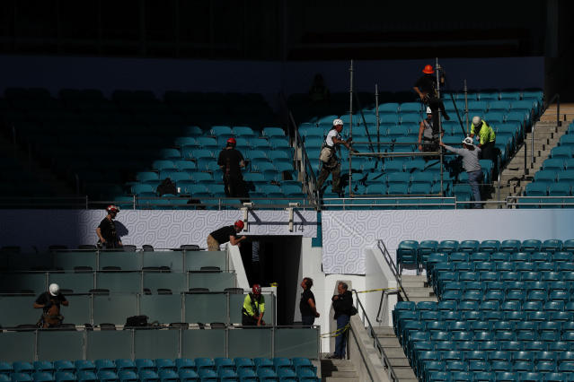 Construction workers are seen during a tour of Hard Rock Stadium on Tuesday, Jan. 21, 2020, ahead of the NFL Super Bowl LIV football game in Miami Gardens, Fla. (AP Photo/Brynn Anderson)
