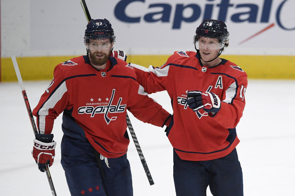 Washington Capitals center Nicklas Backstrom (19) celebrates his goal with center Evgeny Kuznetsov (92) during the first period of the team's NHL hockey game against the Philadelphia Flyers, Tuesday, April 13, 2021, in Washington. (AP Photo/Nick Wass)
