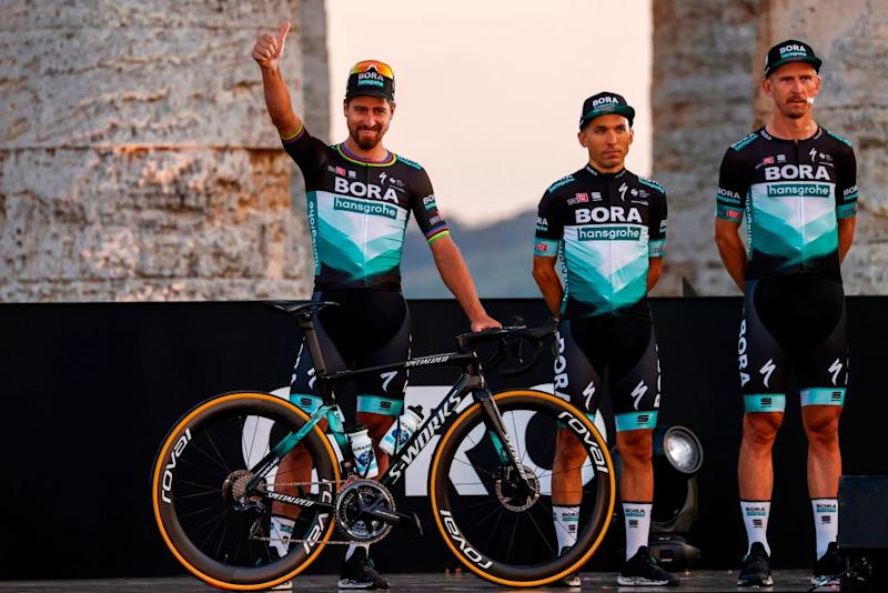 Team Bora rider Slovakias Peter Sagan L waves on stage at the Doric Temple of Segesta near Palermo Sicily on October 1 2020 during an opening ceremony of presentation of participating teams and riders two days ahead of the departure of the Giro dItalia 2020 cycling race Photo by Luca Bettini AFP Photo by LUCA BETTINIAFP via Getty Images
