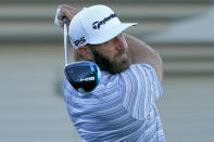 Dustin Johnson plays his shot from the first tee during a practice round prior to the Tournament of Champions golf event, Wednesday, Jan. 6, 2021, at Kapalua Plantation Course in Kapalua, Hawaii. (AP Photo/Matt York)