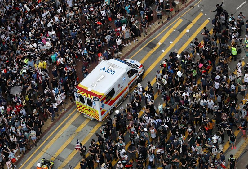 Anti-government protesters make way for an ambulance to pass as they attend a demonstration at Causeway Bay in Hong Kong, China, September 15, 2019. REUTERS/Athit Perawongmetha