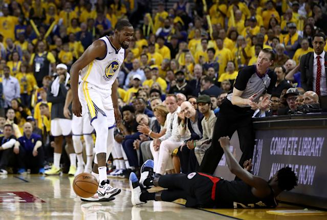 Kevin Durant and Patrick Beverley were ejected after feuding in the Warriors Game 1 win against the Los Angeles Clippers on Saturday night. (Ezra Shaw/Getty Images)