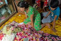 Relatives pay their respects to NLD supporter Aung Than, also known as Aung Aung Zaw, after he was killed overnight in Thaketa township in Yangon