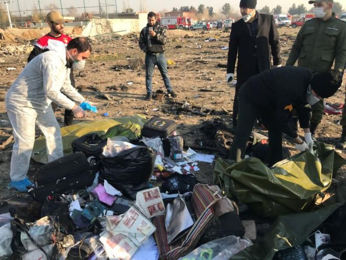Passengers' belongings are seen after the Ukraine International Airlines plane crashed after take-off from Iran's Imam Khomeini airport, on the outskirts of Tehran