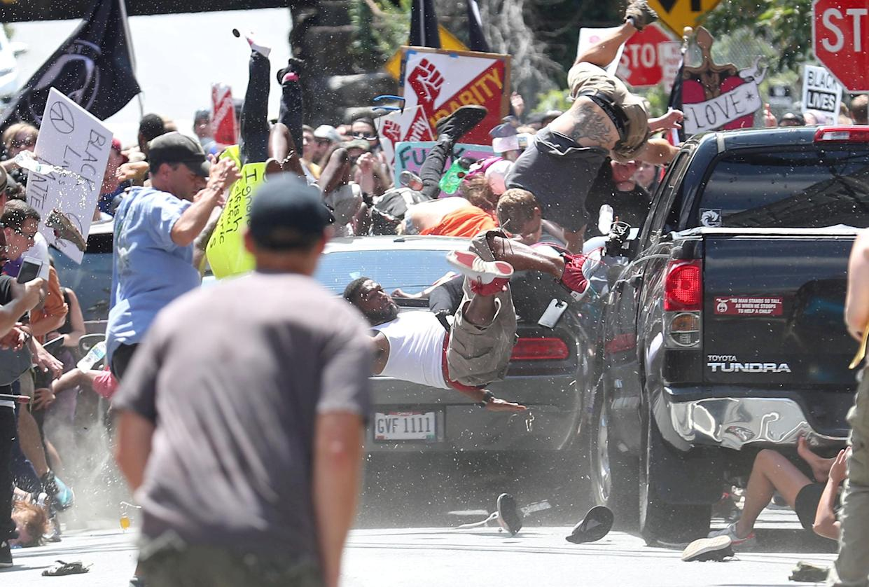 """This Pulitzer Prize-winning photo shows people thrown into the air as a car rams a group counterprotesting a """"Unite the Right"""" rally in Charlottesville on Aug.12, 2017. (Photo: Ryan M. Kelly/Daily Progress via Reuters)"""