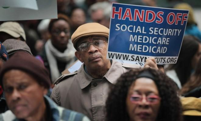 Demonstrators, including many senior citizens, protest against cuts to federal safety net programs.