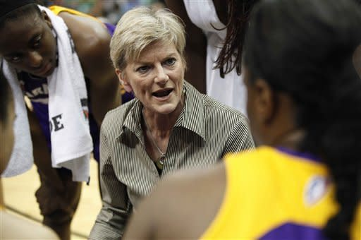 Los Angeles Sparks coach Carol Ross talks with her team during a timeout against the Minnesota Lynx in the first half of a WNBA basketball game, Thursday, May 24, 2012, in Minneapolis. (AP Photo/Stacy Bengs)