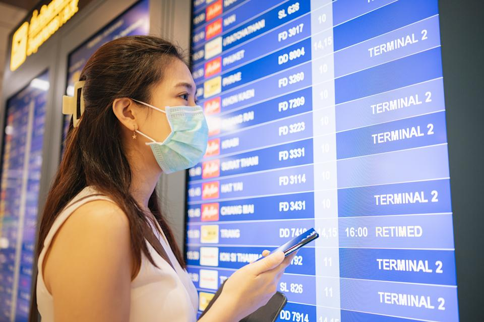 Millennial and GenY Smile thai asian passenger selk check in before entry the airport suwannabhumi