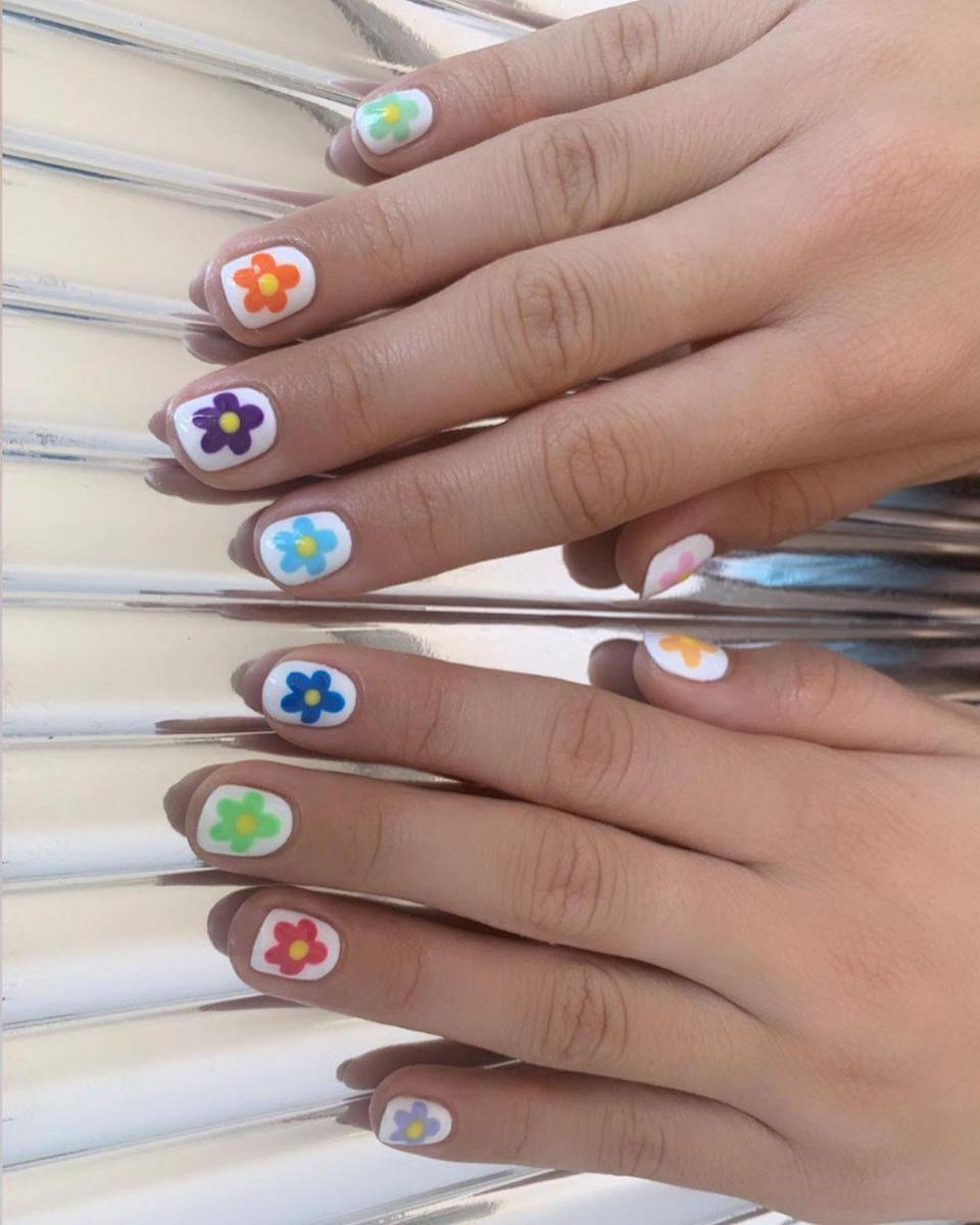 """This multi-hued mani will be the scene stealer in every mirror selfie you take from now until March. An easy way to DIY the look? Try a different color <a href=""""https://www.amazon.com/Stickers-Printing-Transfer-Decoration-Assorted/dp/B08DWKJNQM/ref=sr_1_6?dchild=1&keywords=floral+nail+decals&qid=1603743457&sr=8-6"""" rel=""""nofollow noopener"""" target=""""_blank"""" data-ylk=""""slk:nail sticker"""" class=""""link rapid-noclick-resp"""">nail sticker</a> on each finger."""