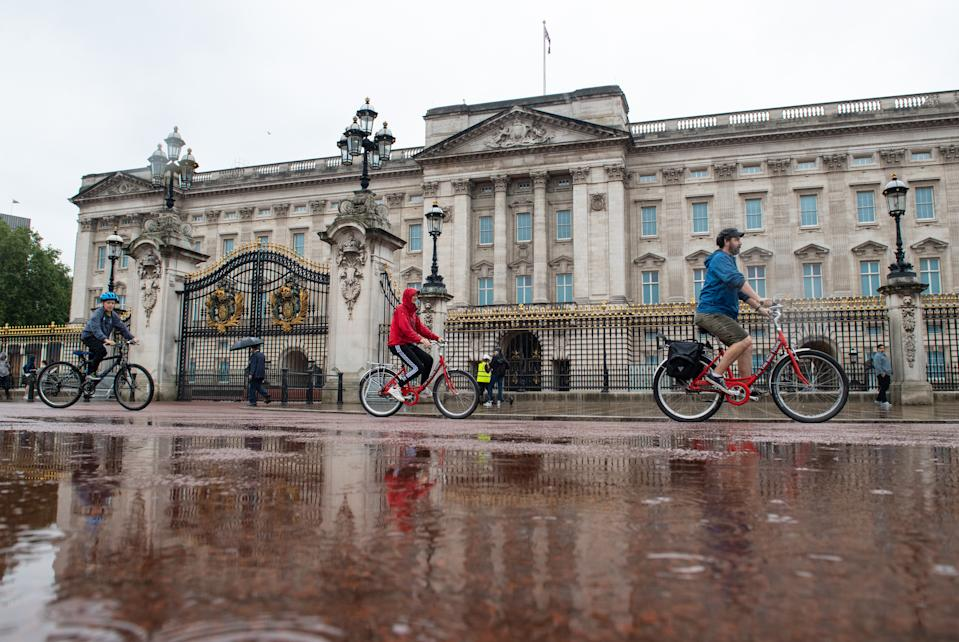 A cycle tour group ride in the rain outside Buckingham Palace, London, as many parts of the UK experience wet weather ahead of the arrival of Storm Ellen, which is forecast to bring strong winds. (Photo by Dominic Lipinski/PA Images via Getty Images)