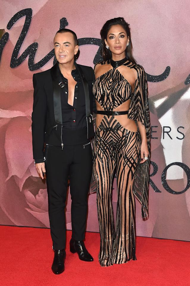 <p>Nicole turned up with the designer responsible for her nearly-naked dress. <i>[Photo: Getty]</i> </p>