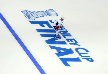 Jun 3, 2014; Los Angeles, CA, USA; New York Rangers forward Martin St. Louis (26) skates past the Stanley Cup Final logo during practice the day before game one of the 2014 Stanley Cup Final against the Los Angeles Kings at Staples Center. Mandatory Credit: Kirby Lee-USA TODAY Sports