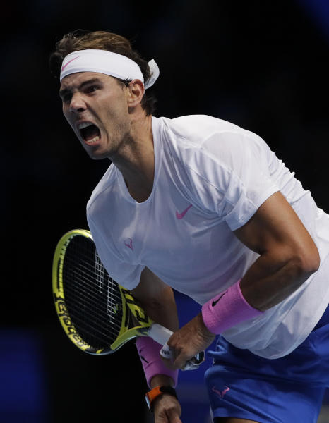Rafael Nadal of Spain serves to Daniil Medvedev of Russia during their ATP World Tour Finals singles tennis match at the O2 Arena in London, Wednesday, Nov. 13, 2019. (AP Photo/Kirsty Wigglesworth)