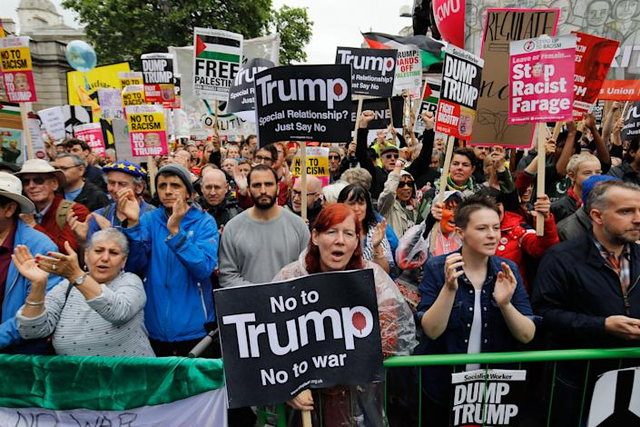Protesters line the barrier on Whitehall during a demonstration against the State Visit of US President Donald Trump in central London on June 4, 2019, on the second day of Trump's three-day State Visit to the UK. - US President Donald Trump turns from pomp and ceremony to politics and business on Tuesday as he meets Prime Minister Theresa May on the second day of a state visit expected to be accompanied by mass protests. (Photo by Tolga AKMEN / AFP) (Photo credit should read TOLGA AKMEN/AFP/Getty Images)
