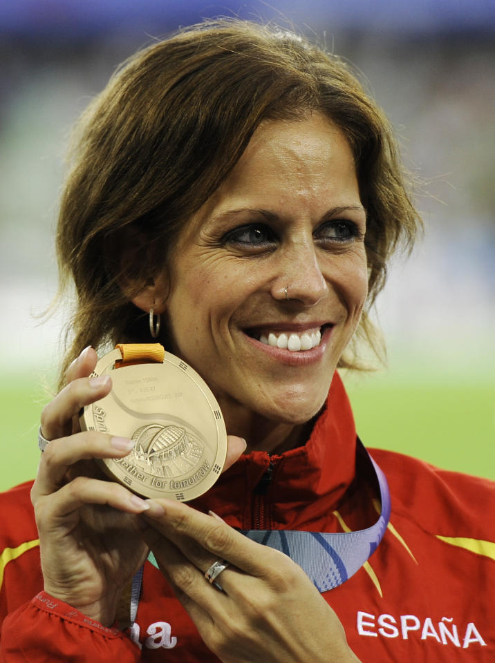 Spain's Natalia Rodriguez poses with her bronze medal for the Women's 1500m at the World Athletics Championships in Daegu, South Korea, Friday, Sept. 2, 2011. (AP Photo/Martin Meissner)