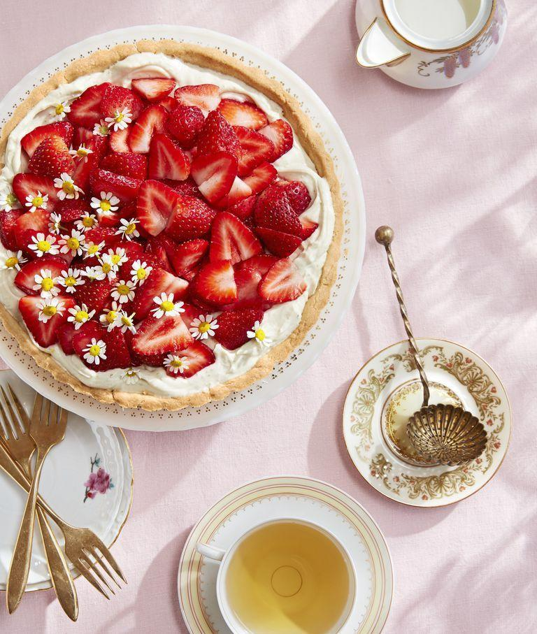 """<p>This tantalizing tart doubles as a <a href=""""https://www.countryliving.com/entertaining/g2256/easter-table-displays-0406/"""" rel=""""nofollow noopener"""" target=""""_blank"""" data-ylk=""""slk:stunning centerpiece"""" class=""""link rapid-noclick-resp"""">stunning centerpiece</a>. </p><p><strong><a href=""""https://www.countryliving.com/food-drinks/a26860932/chamomile-mascarpone-tart-strawberries-recipe/"""" rel=""""nofollow noopener"""" target=""""_blank"""" data-ylk=""""slk:Get the recipe"""" class=""""link rapid-noclick-resp"""">Get the recipe</a>.</strong></p>"""