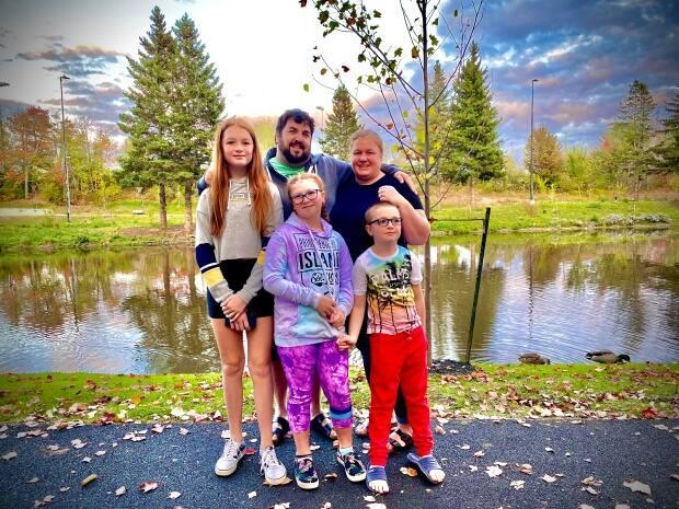 Andy Scott, centre, with wife Sandra and their children, from left, Savannah, Alexis and Reuben. Scott's three children were all at school during the lockdown on Thursday.