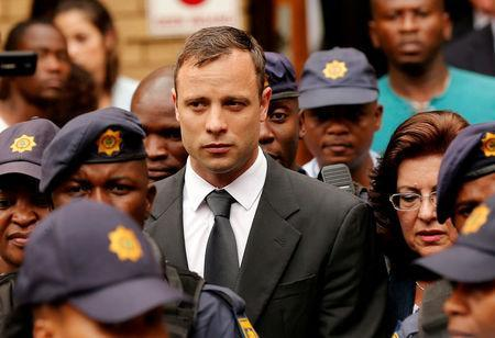 FILE PHOTO: South African Olympic and Paralympic sprinter Oscar Pistorius leaves the North Gauteng High Court in Pretoria, South Africa, October 15, 2014. REUTERS/Siphiwe Sibeko/File Photo