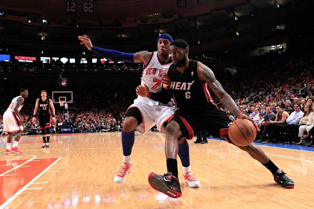NEW YORK, NY - APRIL 15: LeBron James #6 of the Miami Heat drives against Carmelo Anthony #7 of the New York Knicks at Madison Square Garden on April 15, 2012 in New York City. NOTE TO USER: User expressly acknowledges and agrees that, by downloading and/or using this Photograph, user is consenting to the terms and conditions of the Getty Images License Agreement. (Photo by Chris Trotman/Getty Images)