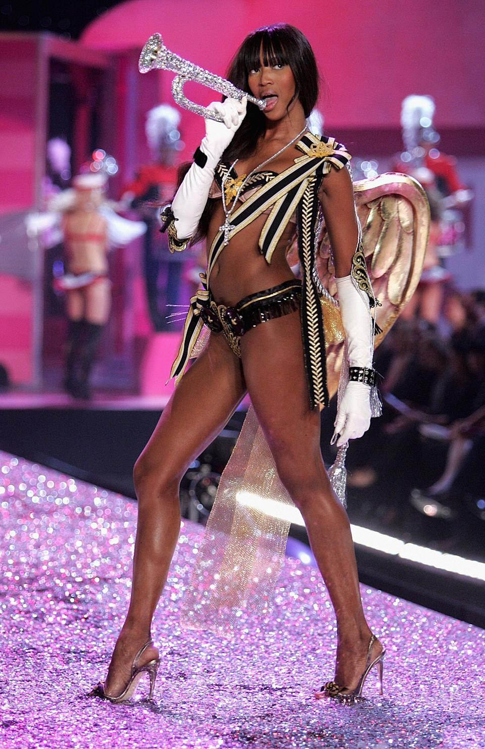Campbell stole the show at The Victoria's Secret Fashion Show in 2005. We can't decide whether it's the gold wings, the barely there stilettos or the diamond-encrusted trumpet that makes this look so iconic. We're going with the trumpet. [Getty Images]