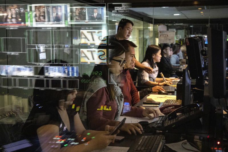 """FILE PHOTO: Members of the crew work inside the control room for """"TV Patrol"""", ABS-CBN's flagship news program, on February 11, 2020 in Quezon city, Metro Manila, Philippines. (Photo by Ezra Acayan/Getty Images)"""