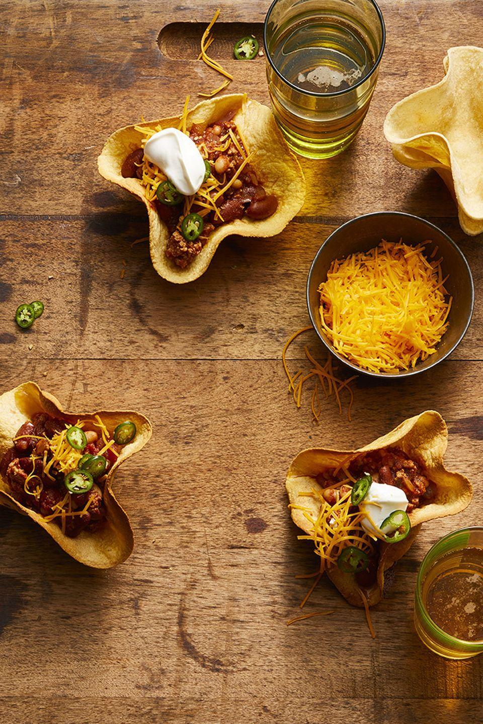 "<p>The Super Bowl is not the time to do dishes, which is why these tortilla bowls come in handy.</p><p><em><a href=""https://www.goodhousekeeping.com/food-recipes/a47668/smoky-maple-turkey-chili-recipe/"" rel=""nofollow noopener"" target=""_blank"" data-ylk=""slk:Get the recipe for Smoky Maple Turkey Chili »"" class=""link rapid-noclick-resp"">Get the recipe for Smoky Maple Turkey Chili »</a></em></p>"