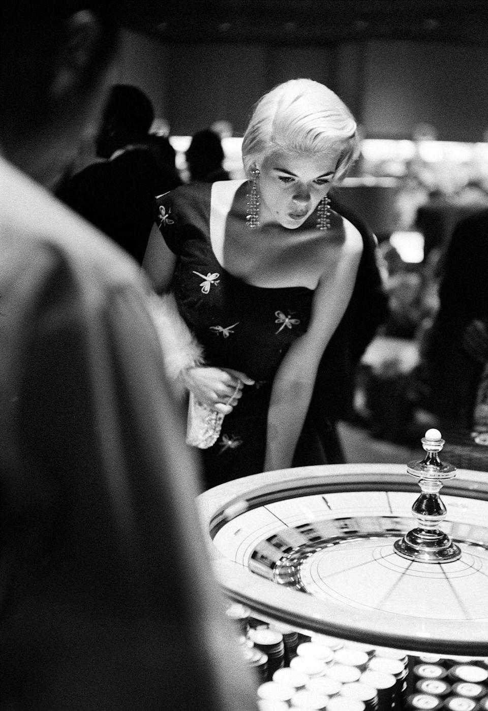 <p>Jayne Mansfield at the roulette table in 1958. The nightclub entertainer and singer was one of the early <em>Playboy</em> Playmates.</p>