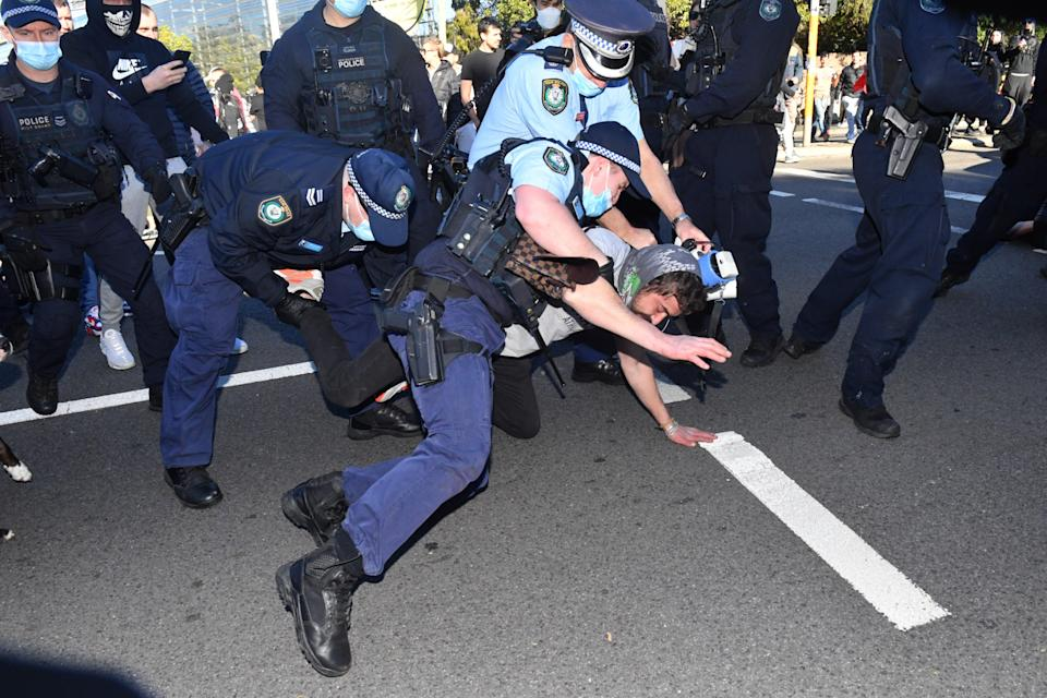 Police arrest protesters at an anti-lockdown rally in Sydney (EPA)
