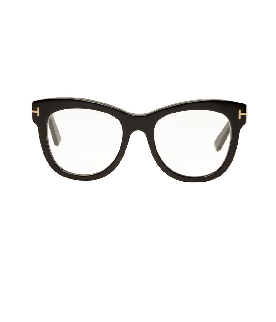 "<p>Cat-eye glasses, $385, <a href=""https://www.ssense.com/en-us/women/product/tom-ford/black-cat-eye-glasses/2721698?utm_source=2687457_CPC&utm_medium=affiliate&utm_campaign=eyeglasses_nonsale&utm_term=CPC"" rel=""nofollow noopener"" target=""_blank"" data-ylk=""slk:ssense.com"" class=""link rapid-noclick-resp"">ssense.com</a> </p>"
