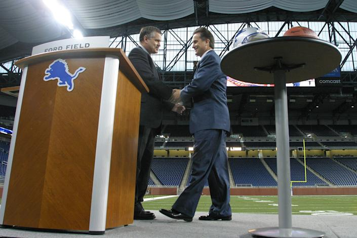 DETROIT- FEBRUARY 5:  Team President Matt Millen greets new Head Coach Steve Mariucci to the Detroit Lions with the media on February 5, 2003 at Ford Field in Detroit, Michigan.  (Photo by Tom Pidgeon/Getty Images)
