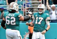 FILE PHOTO: Dec 2, 2018; Miami Gardens, FL, USA; Miami Dolphins quarterback Ryan Tannehill (17) and offensive guard Ted Larsen (62) celebrate a touchdown against the Buffalo Bills during the first half at Hard Rock Stadium. Mandatory Credit: Steve Mitchell-USA TODAY Sports - 11775565