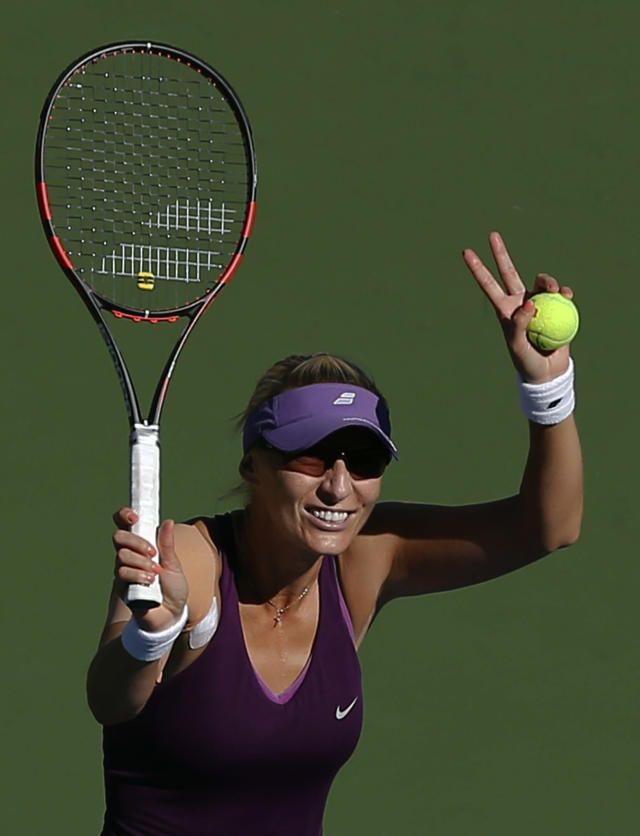 Mirjana Lucic-Baroni, of Croatia, waves to fans after defeating Simona Halep, of Romania, during the third round of the 2014 U.S. Open tennis tournament, Friday, Aug. 29, 2014, in New York. (AP Photo/Elise Amendola)