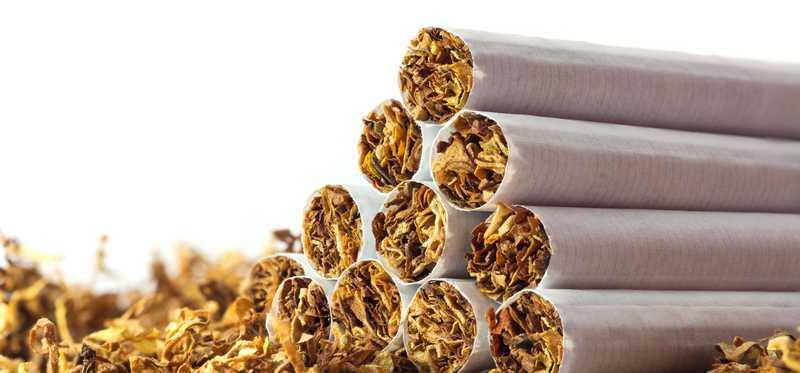 A stack of open tobacco cigarettes.