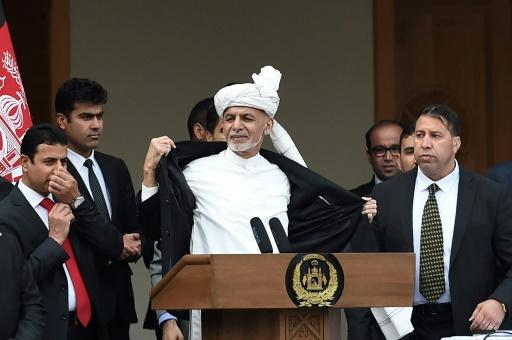 Afghan President Ashraf Ghani (C) had refused to accede to the Taliban's demands but his decree on March 11, 2020, signalled a softening of his stance