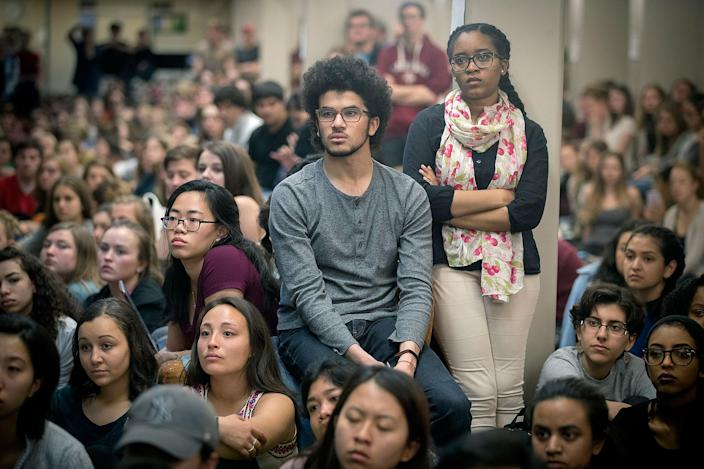 <p>St. Olaf College students fill Tomson Hall to boycott classes and demand action and dialogue after numerous acts of incidents of racial hate on campus, Monday, May 1, 2017 in Northfield, Minn. Hundreds of students boycotted classes at St. Olaf College on Monday, instead packing an administration building to protest a rash of racist and threatening messages left around campus. (Elizabeth Flores/Star Tribune via AP) </p>
