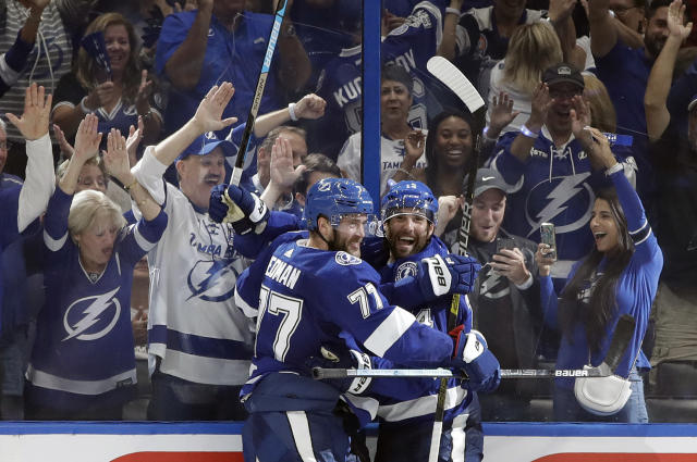 Tampa Bay Lightning left wing Pat Maroon (14) celebrates with defenseman Victor Hedman (77) after scoring against the Florida Panthers during the third period of an NHL hockey game Thursday, Oct. 3, 2019, in Tampa, Fla. (AP Photo/Chris O'Meara)