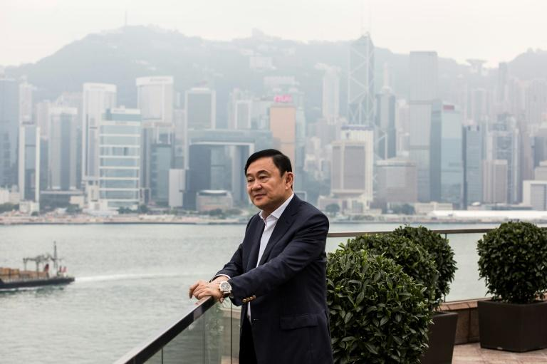 Thaksin was speaking to AFP on Monday afternoon from a luxury hotel in Hong Kong where he watched as results came in from a homeland he has not set foot in for more than a decade