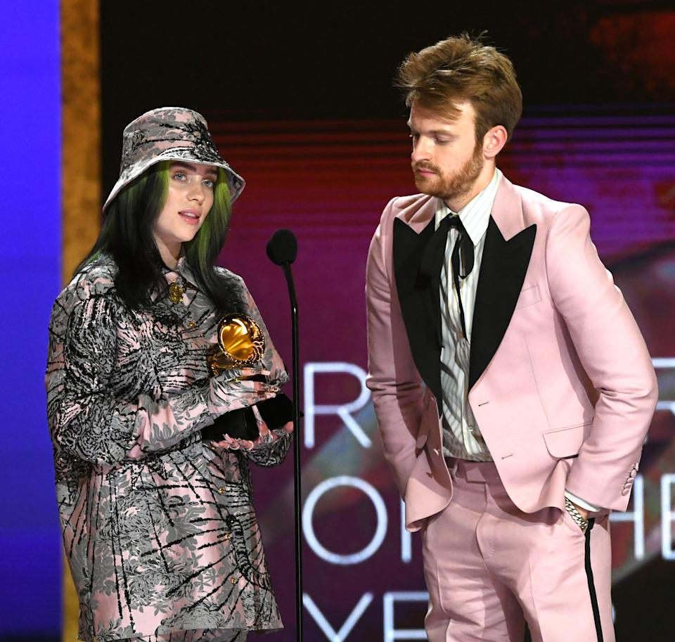 LOS ANGELES, CALIFORNIA - MARCH 14: (L-R) Billie Eilish and FINNEAS accept the Record of the Year award for 'Everything I Wanted' onstage during the 63rd Annual GRAMMY Awards at Los Angeles Convention Center on March 14, 2021 in Los Angeles, California. (Photo by Kevin Winter/Getty Images for The Recording Academy)