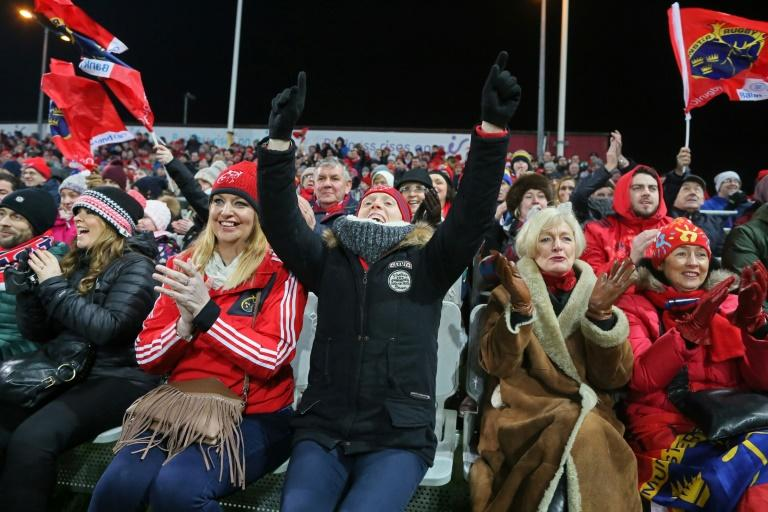 Munster supporters celebrate their first try during the European Rugby Champions Cup pool 1 match against Racing 92, at Thomond Park in Limerick, Ireland, in January 2017