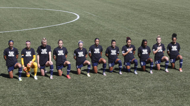The NWSL's players used the opportunity of their return to send a message. (AP Photo/Rick Bowmer)