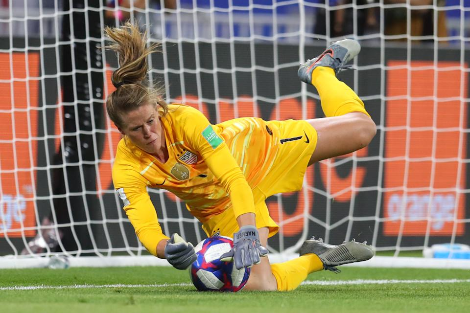 LYON, FRANCE - JULY 02: Alyssa Naeher of the USA saves a penalty during the 2019 FIFA Women's World Cup France Semi Final match between England and USA at Stade de Lyon on July 02, 2019 in Lyon, France. (Photo by Catherine Ivill - FIFA/FIFA via Getty Images)