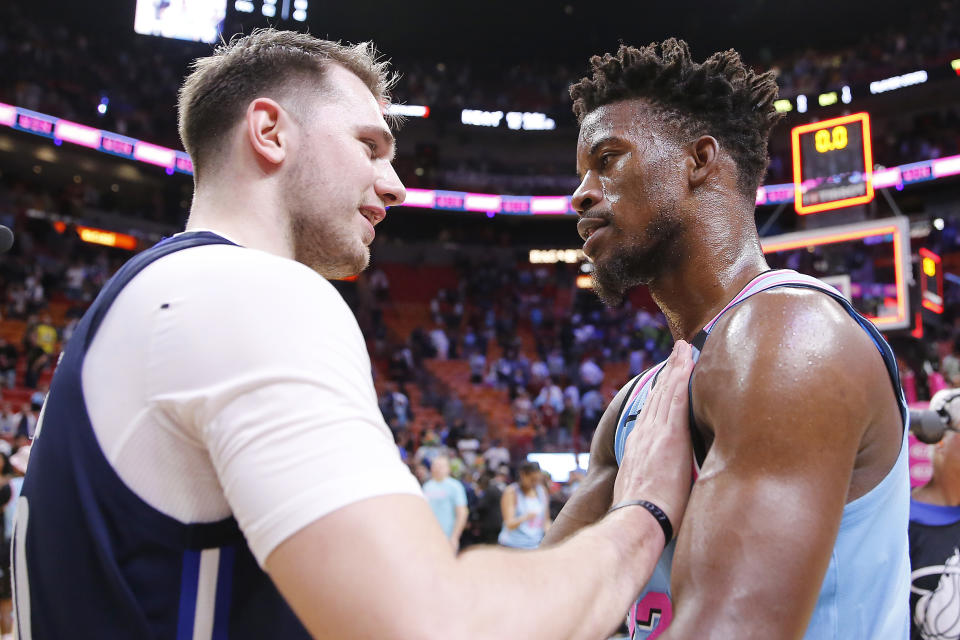 Luka Doncic and Jimmy Butler — a popular preseason MVP pick and last year's Eastern Conference hero — are both in danger of missing the playoffs. (Michael Reaves/Getty Images)