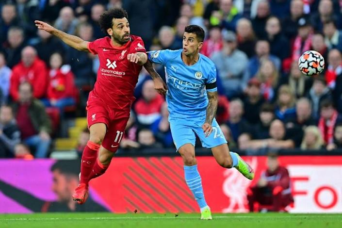 Mohamed Salah (left) scored for the seventh consecutive game in Liverpool's 2-2 draw with Manchester City (AFP/Paul ELLIS)
