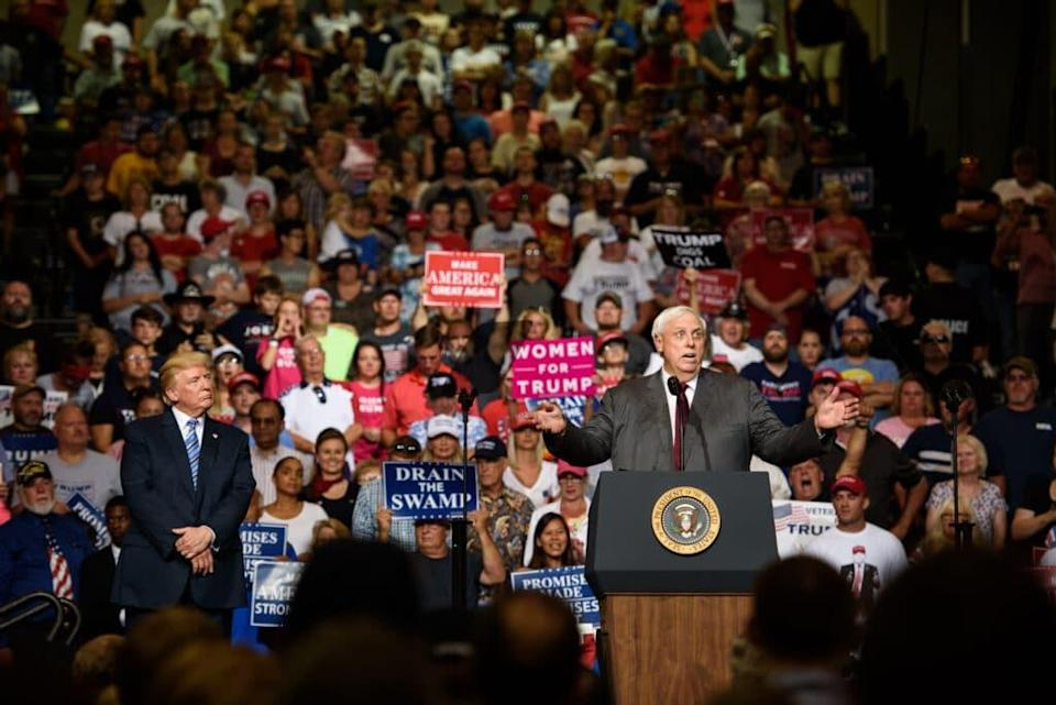 West Virginia governor Jim Justice announces that he is switching parties to become a republican as then-president Donald Trump listen at a campaign rally