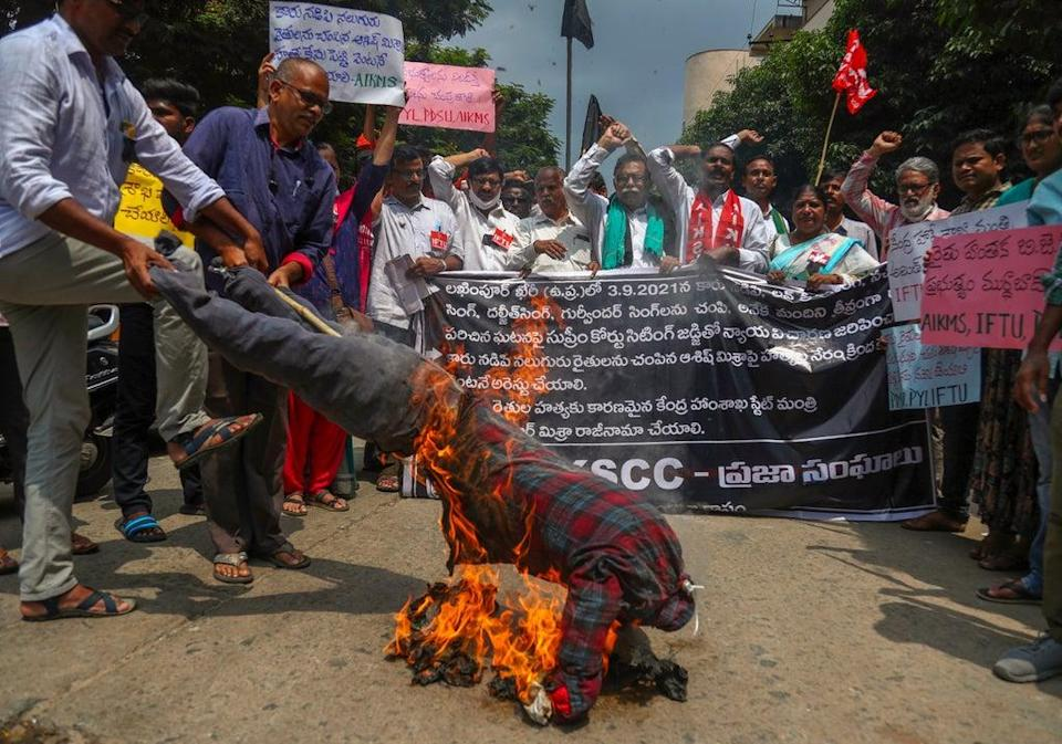 Indian farmers burn effigies on 4 October in Hyderabad to protest against the killing of four farmers in Uttar Pradesh state after being run over by a car owned by India's junior Home Minister Ajay Mishra (AP)