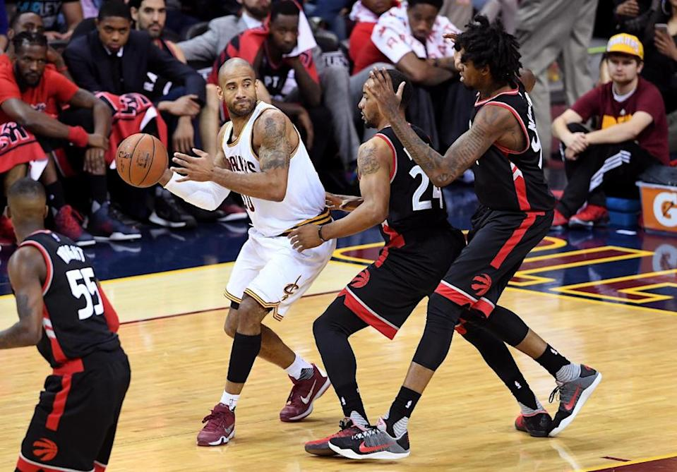 (FILES) CLEVELAND, OH - MAY 17: Dahntay Jones #30 of the Cleveland Cavaliers looks to pass in the fourth quarter against Norman Powell #24 and Lucas Nogueira #92 of the Toronto Raptors in game one of the Eastern Conference Finals during the 2016 NBA Playoffs at Quicken Loans Arena on May 17, 2016 in Cleveland, Ohio. NOTE TO USER: User expressly acknowledges and agrees that, by downloading and or using this photograph, User is consenting to the terms and conditions of the Getty Images License Agreement. Jason Miller/Getty Images/AFPCLEVELAND, OH - MAY 17: Dahntay Jones #30 of the Cleveland Cavaliers looks to pass in the fourth quarter against Norman Powell #24 and Lucas Nogueira #92 of the Toronto Raptors in game one of the Eastern Conference Finals during the 2016 NBA Playoffs at Quicken Loans Arena on May 17, 2016 in Cleveland, Ohio. NOTE TO USER: User expressly acknowledges and agrees that, by downloading and or using this photograph, User is consenting to the terms and conditions of the Getty Images License Agreement. Jason Miller/Getty Images/AFP (AFP Photo/Jason Miller)