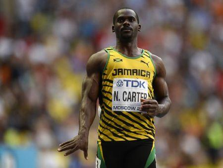 Carter of Jamaica reacts after winning his men's 100 metres heats during the IAAF World Athletics Championships in Moscow