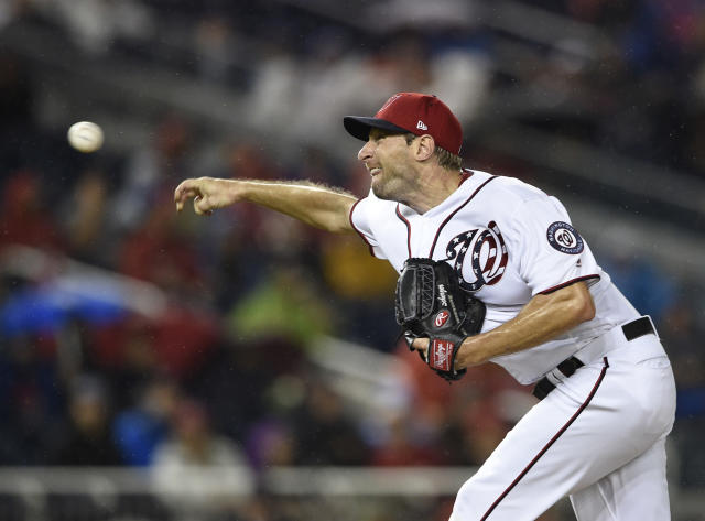 Washington Nationals starting pitcher Max Scherzer delivers during the eighth inning of the first baseball game of a doubleheader against the Chicago Cubs, Saturday, Sept. 8, 2018, in Washington. The Nationals won 10-3. (AP Photo/Nick Wass)