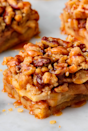 """<p>When you need to make <a href=""""https://www.delish.com/uk/cooking/recipes/a32667262/best-homemade-apple-pie-recipe-from-scratch/"""" rel=""""nofollow noopener"""" target=""""_blank"""" data-ylk=""""slk:apple pie"""" class=""""link rapid-noclick-resp"""">apple pie</a> for a big group, these bars are absolutely perfect. With a no-fuss crust that you press (not roll), they're much easier. Plus, you can't beat that crumb topping. </p><p>Get the <a href=""""https://www.delish.com/uk/cooking/recipes/a32833003/apple-pie-bars-recipe/"""" rel=""""nofollow noopener"""" target=""""_blank"""" data-ylk=""""slk:Apple Pie Bars"""" class=""""link rapid-noclick-resp"""">Apple Pie Bars</a> recipe. </p>"""